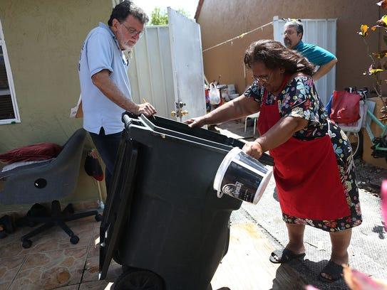 Giraldo Carratala, left, a Miami-Dade County mosquito-control