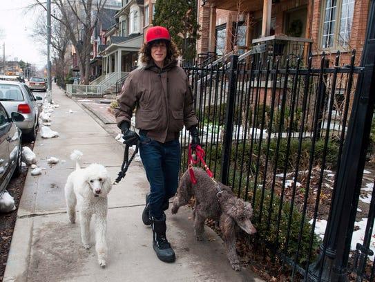 Andrea Constand walks dogs in Toronto, in December