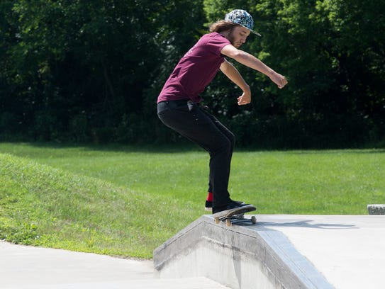 Mirza Jasarovic of Des Moines practices skateboarding