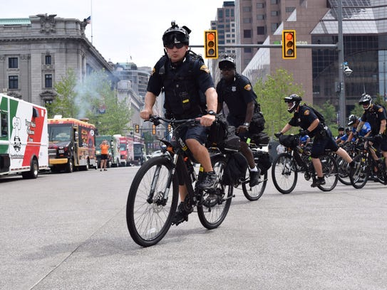 Scores of bike cops can be seen around Quicken Loans