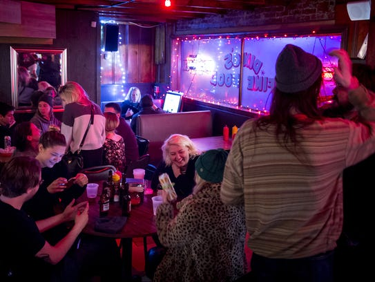 Guests drink and socialize at Dino's, Wednesday, Feb.