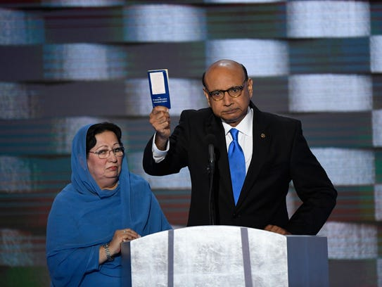 Khizr Khan offers a copy of the Constitution to Donald