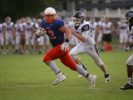 Jacob Garrett, 12, runs the ball for Silver Creek during
