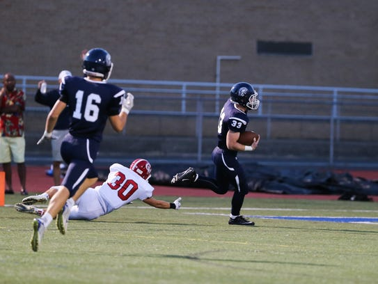 Clay Myers (33) scores Chambersburg's only touchdown