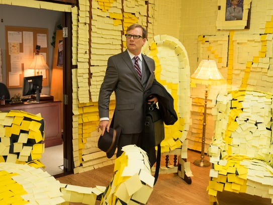 Principal Dwight (Andy Daly) walks in to a Post-it-covered