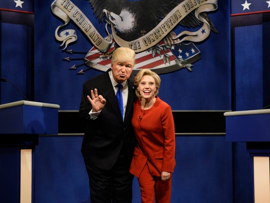 In this photo provided by NBC, Alec Baldwin, left,