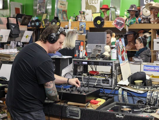 DJ John Clees, left, performs at Detroit Threads during