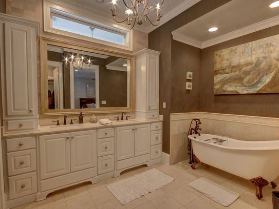 The grand master suite and bath is spacious and luxurious.