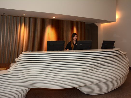 Receptionist Bryanna Newkirk greets guests behind the