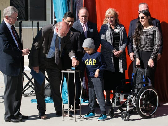 Bradley Becerra pushes the unveiling button during the groundbreaking ceremony for the Loma Linda University Children's Hospital in Indio on Tuesday, Oct. 11, 2016. Bradley's mother, Bibiana, spoke about her experience accessing health care for her son during the ceremony.