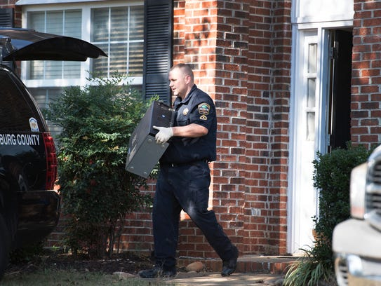 A Spartanburg County sheriff's deputy carries a computer