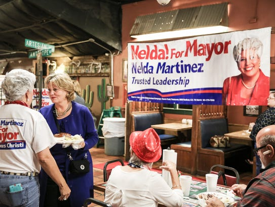 Nelda Martinez visits with supporter Daryl Tanner during