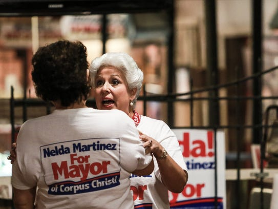 Nelda Martinez embraces a supporter during her election