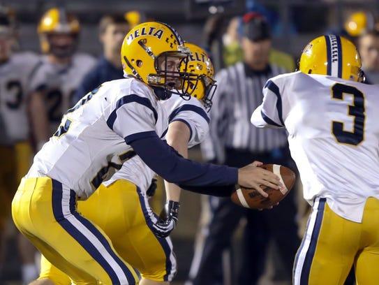 Delta quarterback Tanner Lambert runs a play against