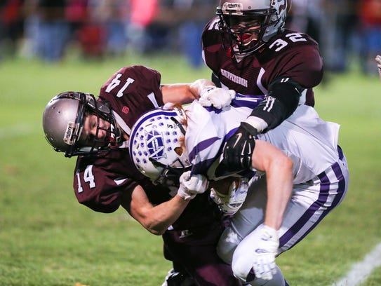 Ship Dylan Jumper (14), tackles NY Curtis Robison (17)