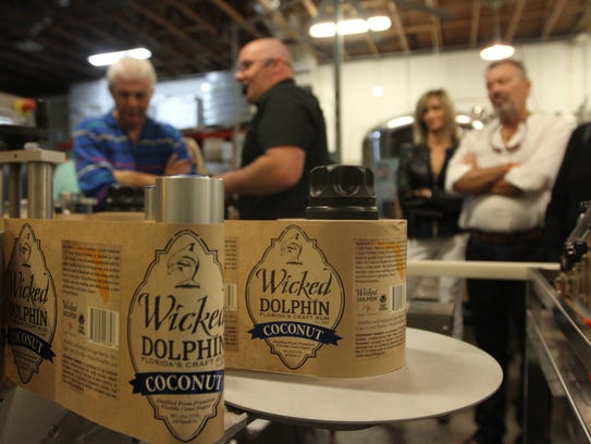 Wicked Dolphin Distillery in Cape Coral bottles rum