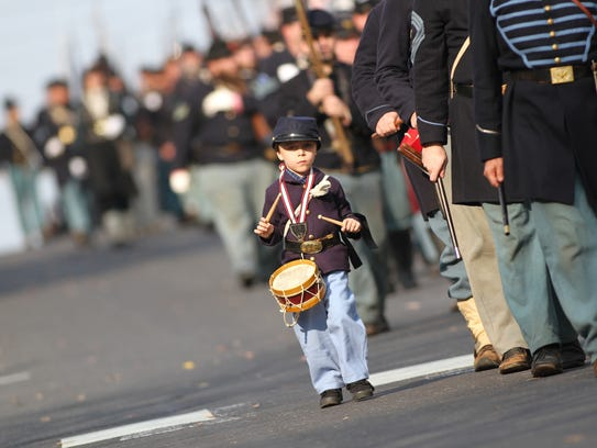 Five-year-old Brandon Murphy of Edensburg, Pa., drums
