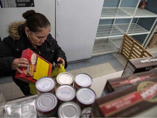 Blanca Hernandez of Lakewood receives help from the