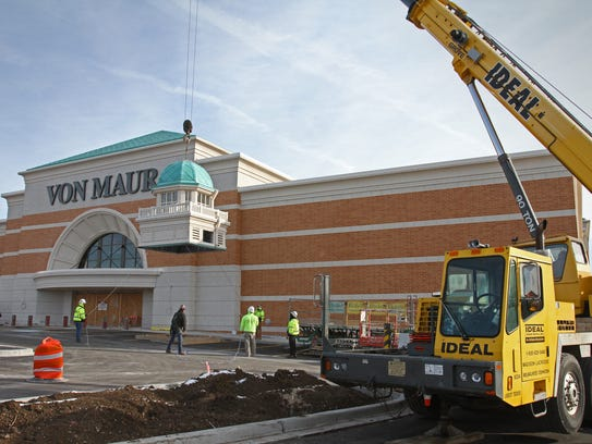Contractors raise one of two cupolas on Dec. 7, signature