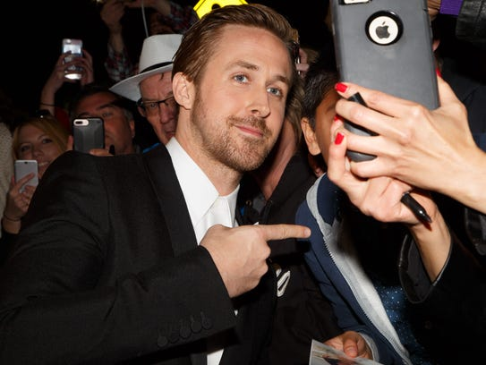 Ryan Gosling poses for a selfie with fans at the Palm