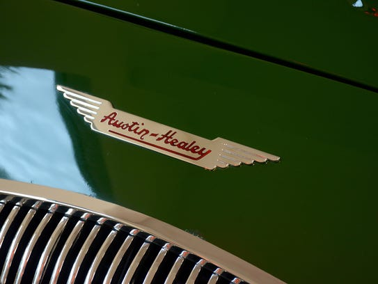 The nameplate on a 1956 Austin-Healey. Owning 16 collectible