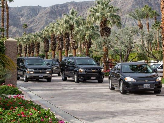 Former president Barack Obama's motorcade leaves Thunderbird