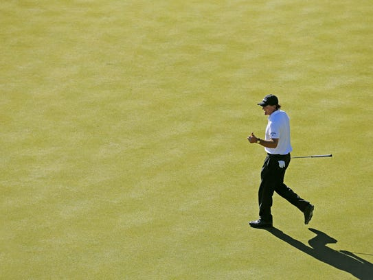 Phil Mickelson gives a thumbs up on the 16th hole during