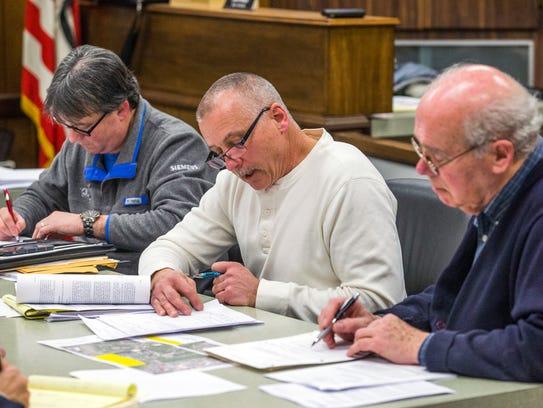 Vestal's Zoning Board of Appeals members Mark Tomko,