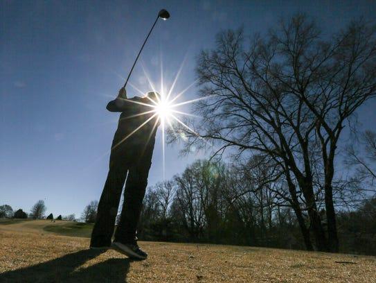 Suzy Boblitt tees off on the front nine at Seneca Golf