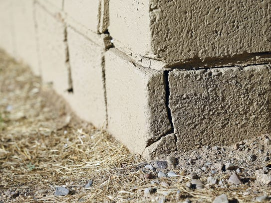 Cracks in the cinder block are visible at Landmark