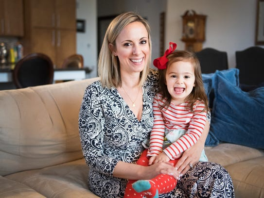 Amber Michels and her daughter, Livy, 2, pose for a