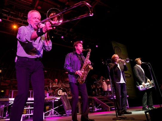 Chicago members James Pankow, Walter Parazaider, Lee Loughnane, Robert Lamm and Jason Scheff perform in 2014.