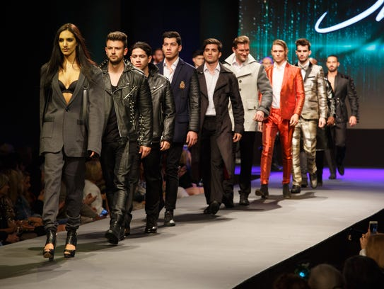 Models walk out onto the runway after showing the Stello