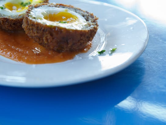 A Scotch Egg is one of the bar food menu items at The