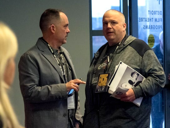 """Steve Byrne, executive director of Freep Film Festival, left, speaks with Shawn Rech, right, the director of the documentary """"White Boy"""" before its premiere at the Detroit Film Theatre at the Detroit Institute of Arts on Friday, March 31, 2017."""