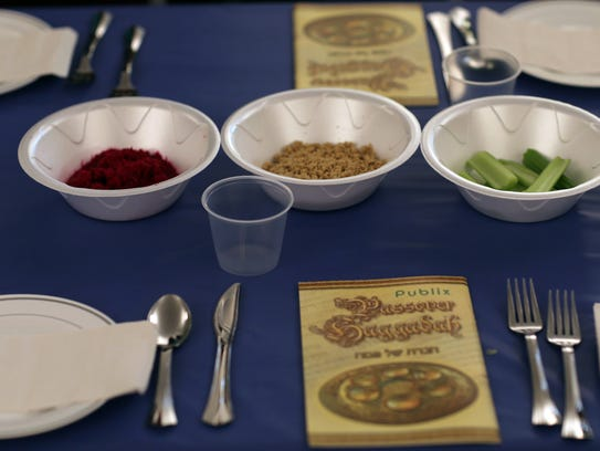 A table is set for a  community Passover Seder at Beth