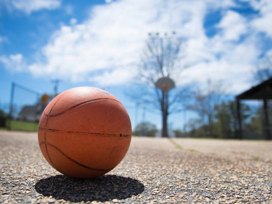 A basketball rests on a court at the Juanita Butler