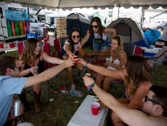 People take grapefruit vodka shots at Country Thunder