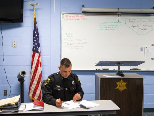 Deputy Will Andres fills out his nightly reports inside