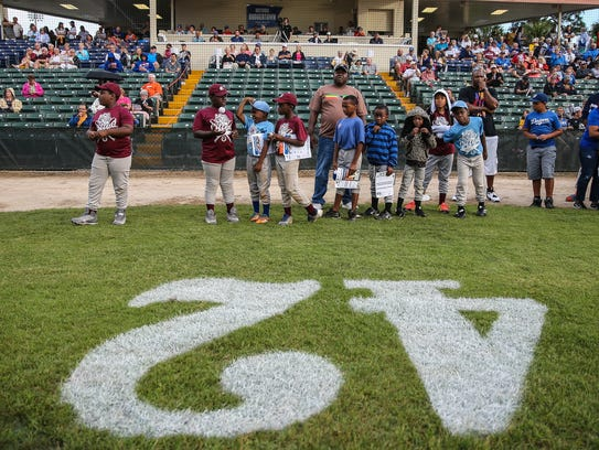 Little Leaguers participate in some of the festivities