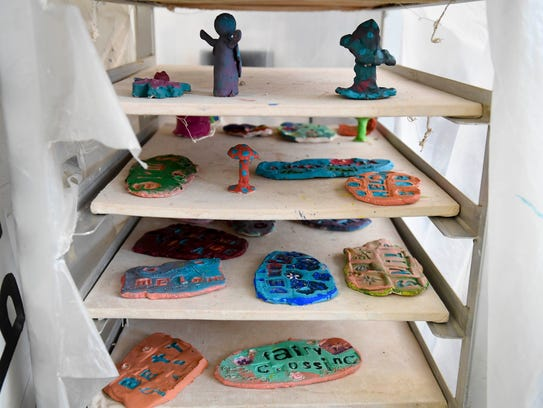 Finished art projects wait to fired in the kiln as