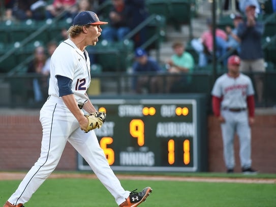 Auburn left-handed pitcher Andrew Mitchell yells after