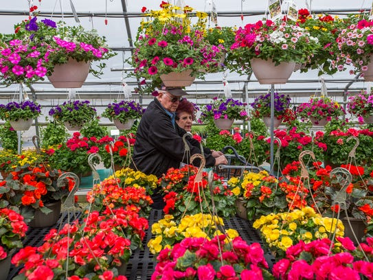 Shoppers browse the aisles of flowers Tuesday at S