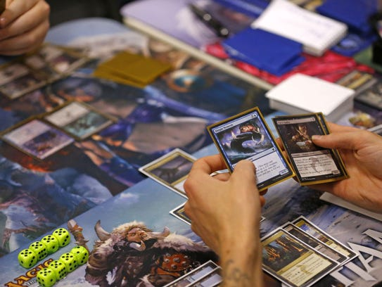 Patrons play Magic The Gathering at Samurai Comics