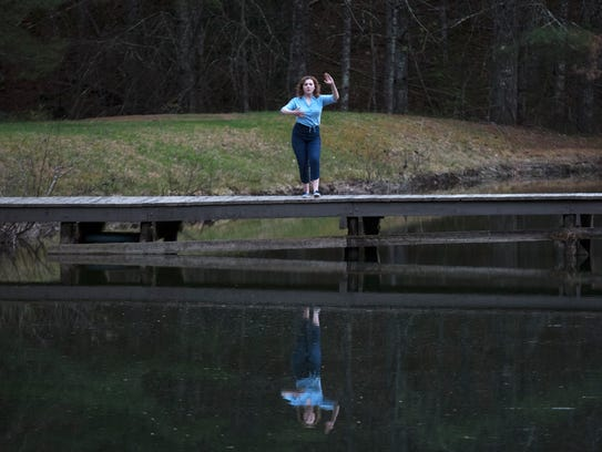 Abigail Breslin stands on the shores of Lake Kanuga