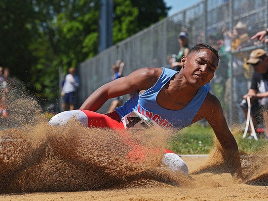 Lincoln's Malik Redd competes in the boys long jump
