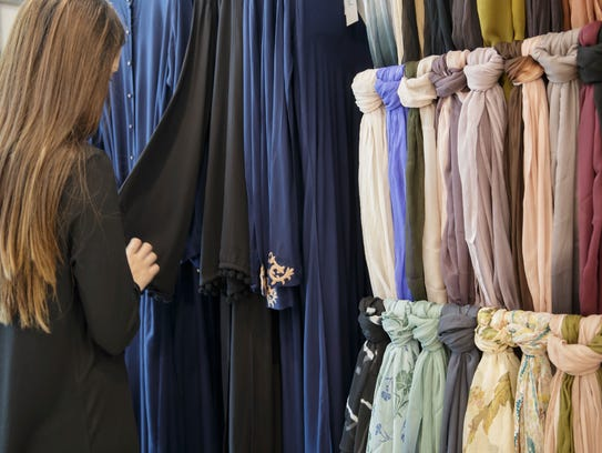 Scarves hang from a wall at the Aab boutique at Upton