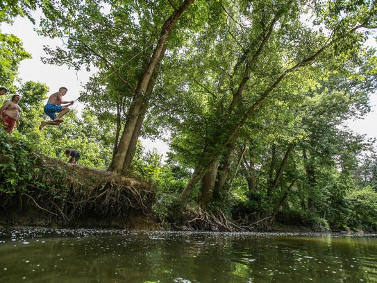 Logan Hall swings out over Floyds Fork.June 13, 2017