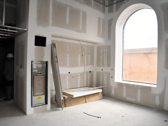Arched windows in one of the one-bedroom suites of