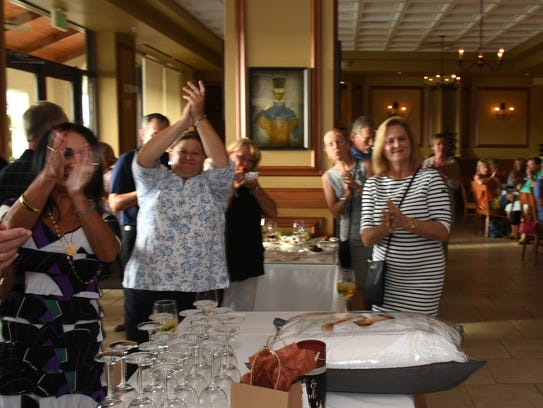 Patrons celebrate the auctioned dinner hosted by Chef